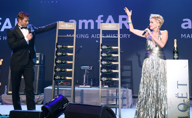 © GettyImages, amfARGalaCannes2014, SharonStone and Kellan Lutz with Moët&Chandon Auction